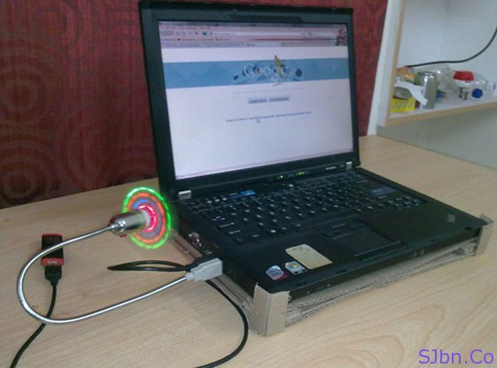Side View Of Cooling Pad Made With Laptop